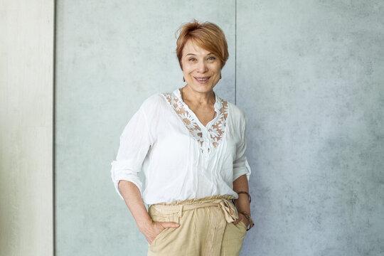 Happy mature lady portrait. Senior woman smiling indoor