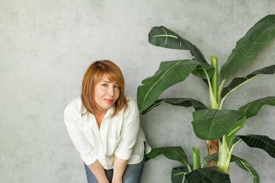 Attractive redhead woman posing and smiling at camera