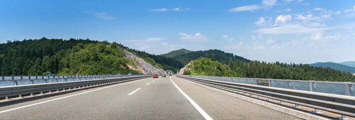 Fototapeta Cars are driving on the expressway or autobahn. obraz