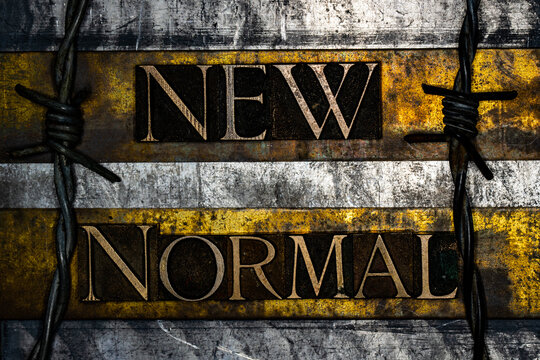 New Normal text on vintage textured grunge copper gold and silver background