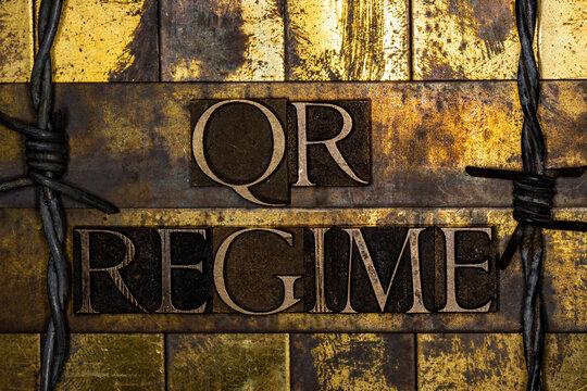 QR Regime text on textured grunge copper and vintage gold background