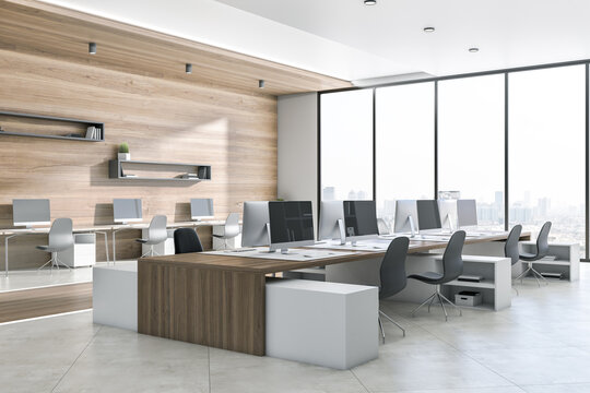 Luxury wooden and concrete coworking office interior with equipment, furniture, different objects, city view and sunlight. 3D Rendering.
