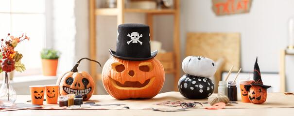 Fototapeta Classic carven spooky jack-o-lantern in pirate hat standing on wooden table obraz