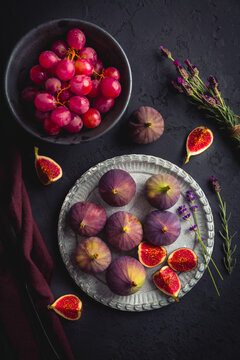 Organic fresh figs with red grapes and lavender