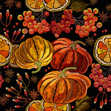 Embroidery pumpkin, lemon slice and red berries of mountain ash. Seamless pattern. Fashion template for clothes, t-shirt design
