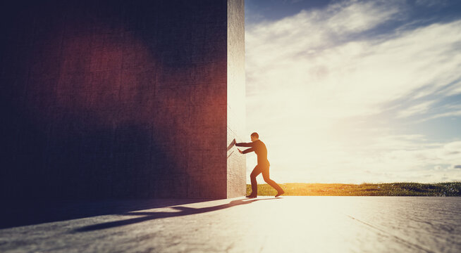 Man pushing big wall to reveal new better green world