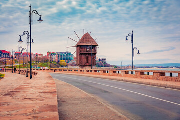 Fototapeta Attractive morning scene of Old Town of Nessebar with old wooden windmill. Stunning spring scene of Bulgaria, Europe. Traveling concept background. obraz