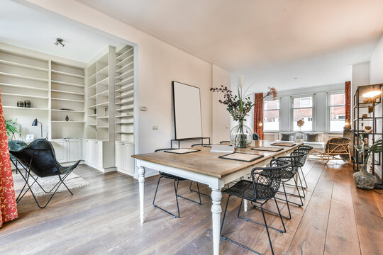Dinning table with vase with flowers and of cozy loggia in apartment