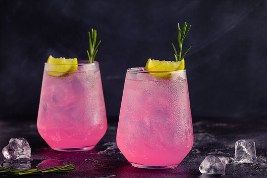 Refreshing pink drink or cocktail with ice
