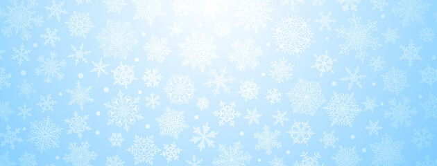 Fototapeta Christmas background of big and small complex snowflakes in light blue colors obraz