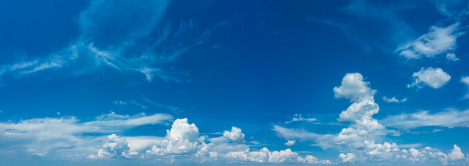 Fototapeta Deep blue sky and different types of white clouds in it. Beautiful nature background. obraz