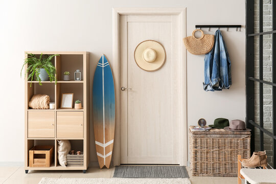 Interior of modern stylish hall with surfboard