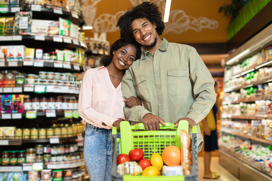Black Couple On Grocery Shopping Posing With Shop Cart Indoor