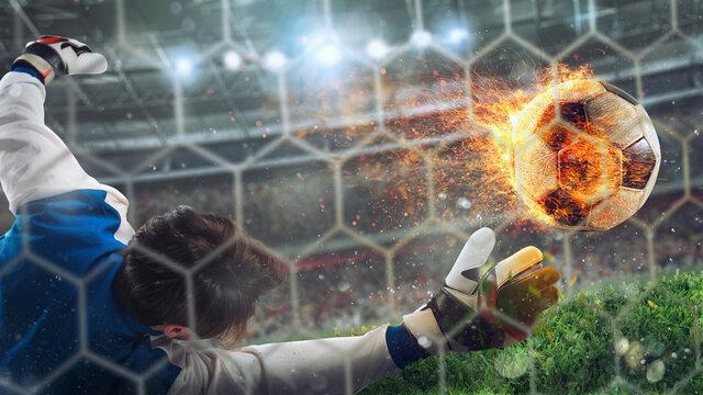 Goalkeeper catches a fast fiery soccer ball