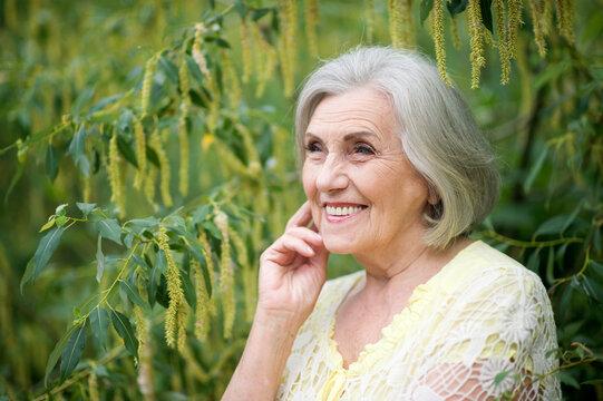 Close up portrait of happy senior woman in park