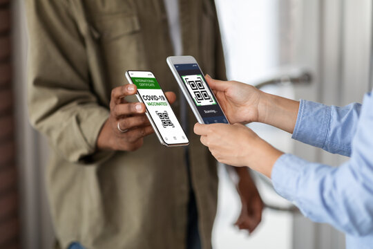 Vaccination Certificate. Black Man Showing Smartphone With Digital Qr Code Health Passport