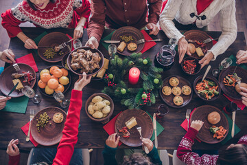 Fototapeta Top view photo family sitting at festive table eating delicious food celebrating winter holidays obraz