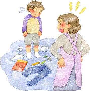 部屋を散らかす子供を𠮟る母親