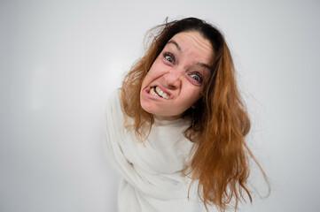 Obraz Close-up portrait of insane woman in straitjacket on white background. - fototapety do salonu