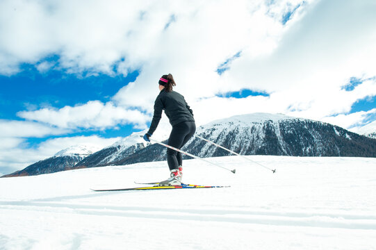 A young woman practicing Nordic skiing