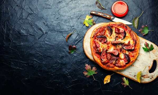 Tasty meat pizza with fig,space for text