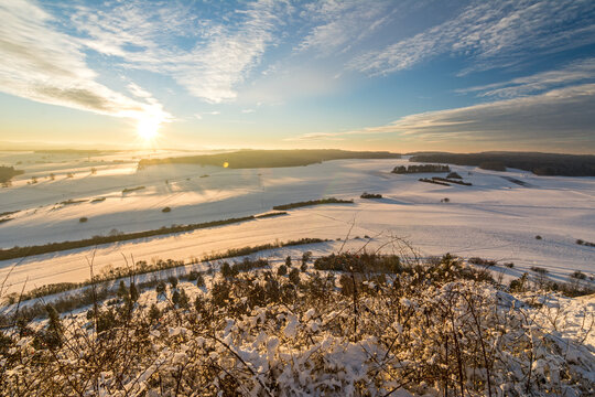 Panorama view of beautiful snowy winter landscape in the Swabian Alps at sunset