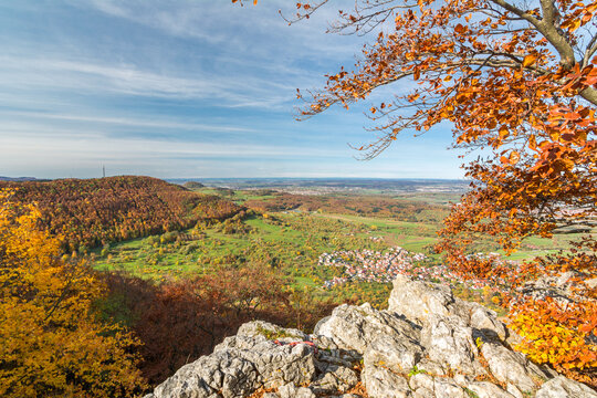 View from a cliff ledge over beautiful autumn landscape in the Swabian Alps in Southern Germany