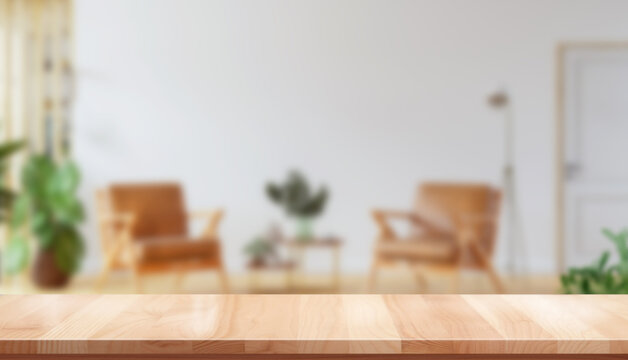 empty wooden table with blurred modern apartment interior background