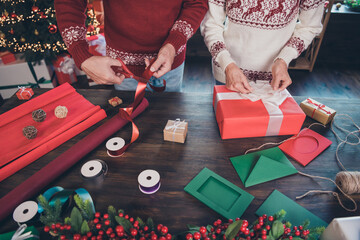 Fototapeta Cropped photo of two handy grandparents prepare packing presents wear ornament pullover home indoors obraz