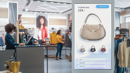 Obraz Shot of a Floor-Standing LCD Touch Screen Display with User Interface of Online Clothing Shop Standing in Clothing Store. Self service Checkout. Diverse People in Fashionable Shop Buying Clothes. - fototapety do salonu