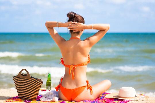 Young pretty sexy asian woman in bikini on tropical beach. summer vacation.