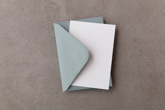 Blank white card with grey paper envelope template mock up on a concrete background