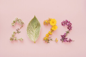 Fototapeta 2022 made from natural plants, leaves and flowers, Happy New Year wellness and healthy lifestyle resolutions, holidays retreat and spa concept obraz