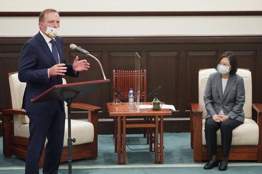 Former Australian Prime Minister Tony Abbott speaks next to Taiwan's President Tsai Ing-wen during their meeting in Taipei