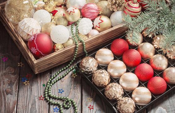 Christmas balls in box on dark wooden background