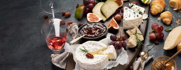 Fototapeta Cheese assortment on dark background. obraz