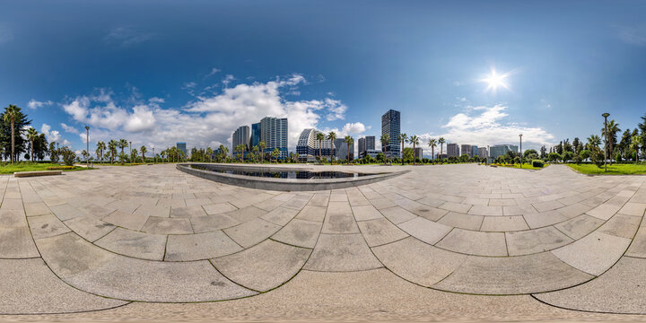 360 seamless hdri panorama view on square near seashore or ocean with skyscrapers with blue sky and good weather in equirectangular spherical projection, ready AR VR virtual reality content