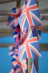 Fototapeta Lots of little English flags like an advertisement for an English school obraz