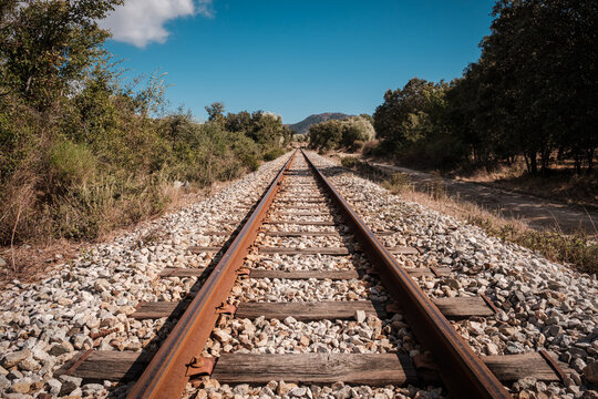 View along the parallel lines of a railway track near Belgodere in the Balagne region of Corsica