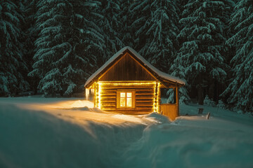 Obraz Fantastic winter landscape with glowing wooden cabin in snowy forest. Cozy house in Carpathian mountains. Christmas holiday concept - fototapety do salonu