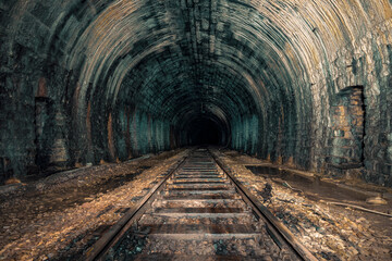Fototapeta An old abandoned railway tunnel decayed for decades a lost place obraz