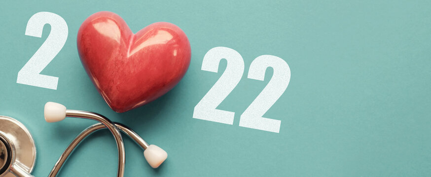 2022 with Red heart nad stethoscope, heart health,  health insurance concept, new year resolutions goal