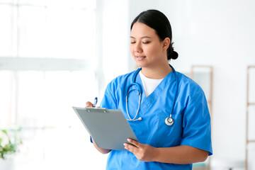 Fototapeta Portrait of female Asian doctor in clinic obraz