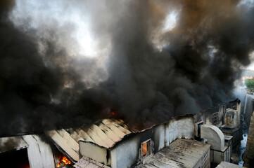 Fototapeta Fire burning and black smoke over the factory obraz