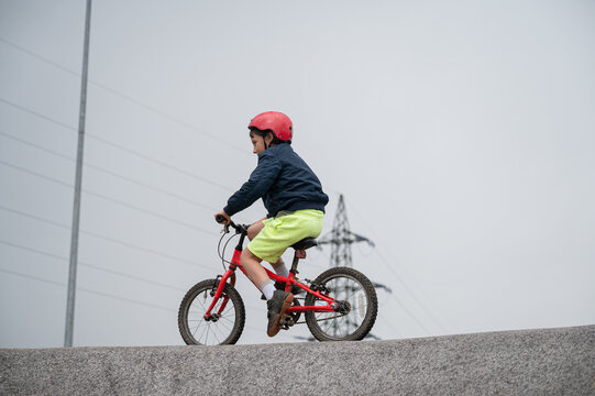 Young boy cycling pump track