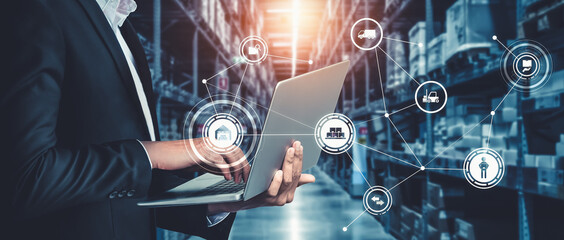 Obraz Smart warehouse management system with innovative internet of things technology to identify package picking and delivery . Future concept of supply chain and logistic network business . - fototapety do salonu