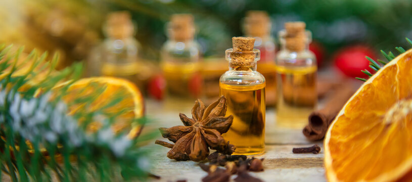 Christmas essential oils in small bottles. Selective focus.
