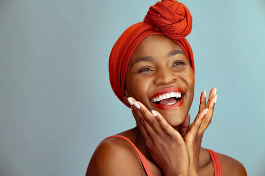 Laughing african american woman wearing red headband