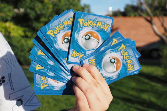 SAN MARTIN DE LA VEGA, SPAIN - Oct 06, 2021: Boy holding some pokemon cards