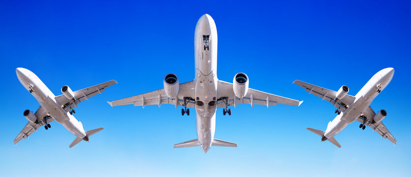 modern airliner against a perfect blue sky